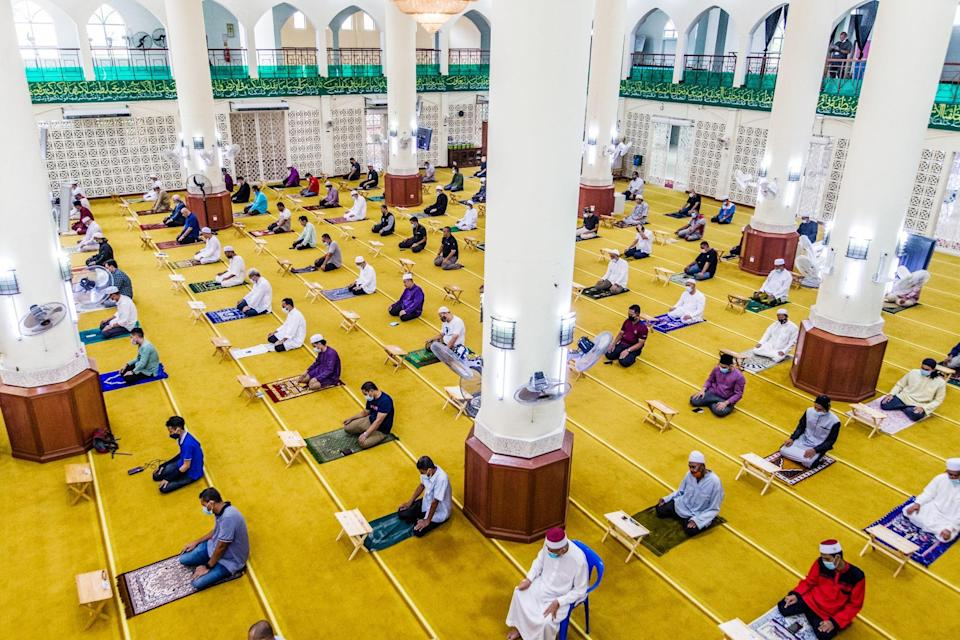 Muslims are spaced out at one-metre intervals to perform the compulsory Friday prayers at the Al-Hidayah Mosque in Kampung Sungai Penchala, Selangor. ― Picture by Firdaus Latif
