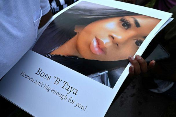PHOTO: A mourner holds a photo of Taya Ashton at a gathering for the 20-year-old  transgender woman who was shot and killed at her apartment in Suitland, Md., July 21, 2021. (Marvin Joseph/The Washington Post via Getty Images)