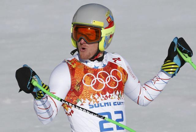 Ted Ligety of the U.S. reacts in the finish area after competing in the downhill run of the men's alpine skiing super combined event during the 2014 Sochi Winter Olympics at the Rosa Khutor Alpine Center in Rosa Khutor February 14, 2014. REUTERS/Leonhard Foeger (RUSSIA - Tags: OLYMPICS SPORT SKIING)