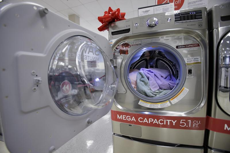 In this Thursday, Dec. 6, 2012, photo, aa new washer is displayed in the appliance department at a Sears store in North Olmsted, Ohio.  U.S. demand for long-lasting manufactured goods rose sharply in December on strong gains in volatile aircraft orders. But companies slowed their orders of goods that signal investment plans, indicating manufacturing could stay choppy in 2013. (AP Photo/Mark Duncan)