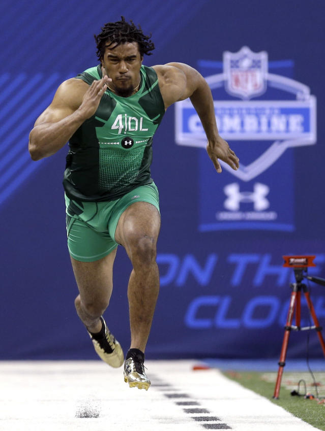 Clemson defensive lineman Vic Beasley runs the 40-yard dash at the NFL football scouting combine in Indianapolis, Sunday, Feb. 22, 2015. (AP Photo/David J. Phillip)