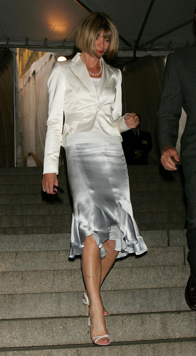 THEN: Anna Wintour put the versatile silvery slip skirt on the map.