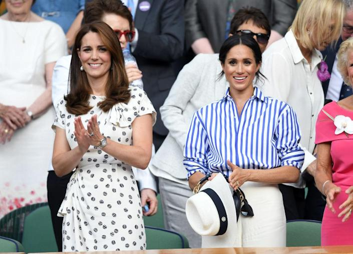 Meghan Markle (right) beat sister-in-law the Duchess of Cambridge in the beauty stakes, pictured at Wimbledon in July 2018 in London, England. (Getty Images)