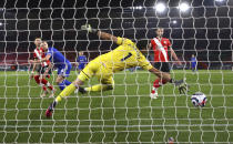 Leicester's Jonny Evans, second left, scores his side's opening goal during the English Premier League soccer match between Southampton and Leicester City at St. Mary's Stadium in Southampton, England, Friday, April 30, 2021. (Michael Steele/Pool via AP)