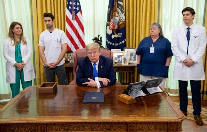 US President Donald Trump speaks about COVID-19 in the Oval Office of the White House (AFP Photo/SAUL LOEB)
