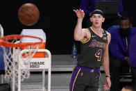 Los Angeles Lakers guard Alex Caruso watches his shot go in during the first half of an NBA basketball game against the Denver Nuggets Monday, May 3, 2021, in Los Angeles. (AP Photo/Mark J. Terrill)
