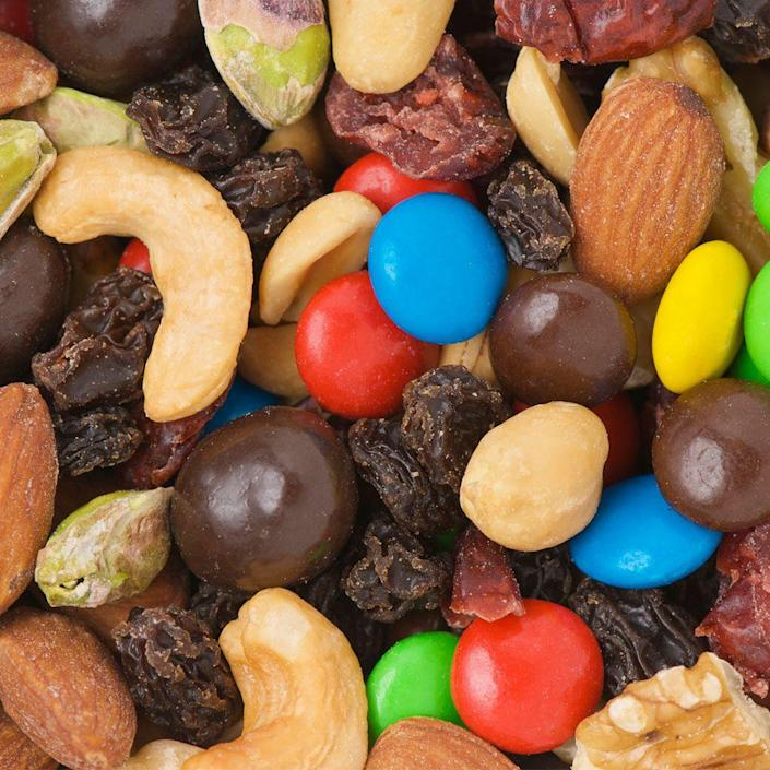 """<p>Go nuts for nuts—just not all the other ingredients in most pre-made trail mixes, like dried and sweetened cranberries and high-sugar milk chocolate. Many store-bought mixes also pack in added sugars, salts, and oils, adds Moskovitz. """"Look for nut mixes that just have nuts as the ingredients, or make your own mix at home by combining raw nuts in a baggy,"""" she suggests—then stick to a serving size of just couple of tablespoons to keep calories in check.</p>"""