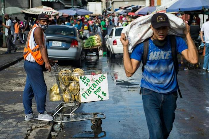 A man sells plantains in a market in Caracas, Venezuela on December 5, 2020 on the eve of legislative voting