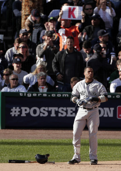 New York Yankees' Robinson Cano reacts after striking out in the first inning during Game 4 of the American League championship series against the Detroit Tigers Thursday, Oct. 18, 2012, in Detroit. (AP Photo/Charlie Riedel)