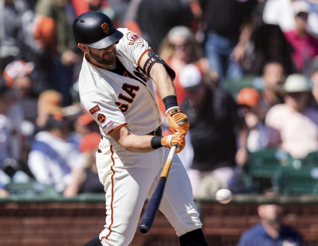 San Francisco Giants' Evan Longoria hits a single against the Miami Marlins in the fourth inning of a baseball game in San Francisco, Sunday, Sept. 15, 2019. (AP Photo/John Hefti)