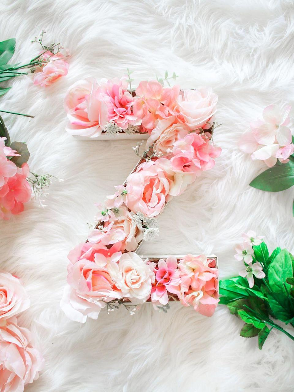"""<p>Whether she uses this floral beauty to dress up her door, wall, or shelf, it'll make her smile every time she looks at it. Trust. </p><p><em><a href=""""https://thediaryofadebutante.com/diy-monogram-door-hanger-flowers/"""" rel=""""nofollow noopener"""" target=""""_blank"""" data-ylk=""""slk:Get the tutorial at Diary of a Debutante »"""" class=""""link rapid-noclick-resp"""">Get the tutorial at Diary of a Debutante » </a></em> </p>"""
