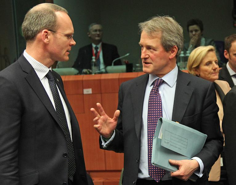 British Secretary of State for the Environment, Food, & Rural Affairs Owen William Paterson, right, talks with President of the EU rotating Council and Ireland's Agriculture Minister Simon Coveney, at the European Council building in Brussels, Wednesday, Feb. 13, 2013. Agriculture ministers from the EU countries most affected by the scandal over horse meat found in products labelled as beef, were due to meet for an exchange of information in Brussels on Wednesday evening. (AP Photo/Yves Logghe)