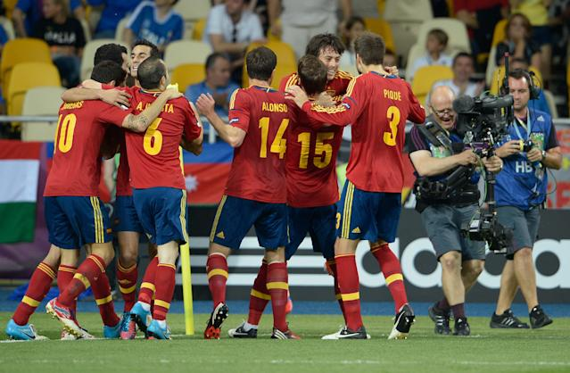 KIEV, UKRAINE - JULY 01: David Silva (2R) of Spain celebrates with his team-mates after scoring the opening goal during the UEFA EURO 2012 final match between Spain and Italy at the Olympic Stadium on July 1, 2012 in Kiev, Ukraine. (Photo by Claudio Villa/Getty Images)