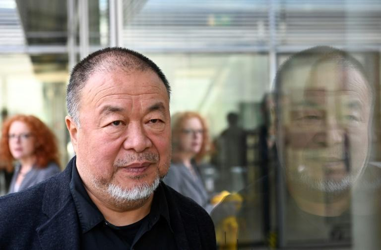 A photo showing Chinese dissident artist Ai Weiwei flipping a middle finger in Tiananmen Square will not be displayed at M+, an official says