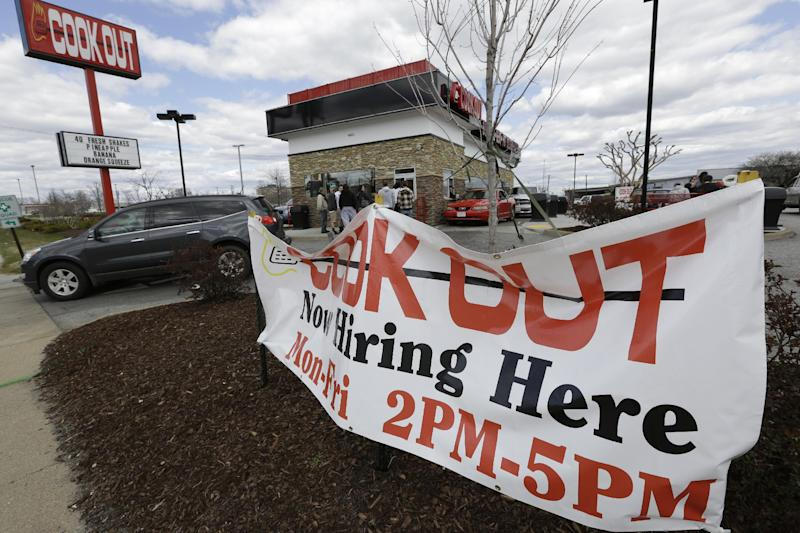 This  Friday, March 29, 2013, photo, shows a help wanted sign in front of a restaurant in Richmond, Va.  The U.S. economy has enjoyed a four-month stretch of robust job gains, and on Friday, April 5, 2013, the government will signal whether that trend endured into March  (AP Photo/Steve Helber)
