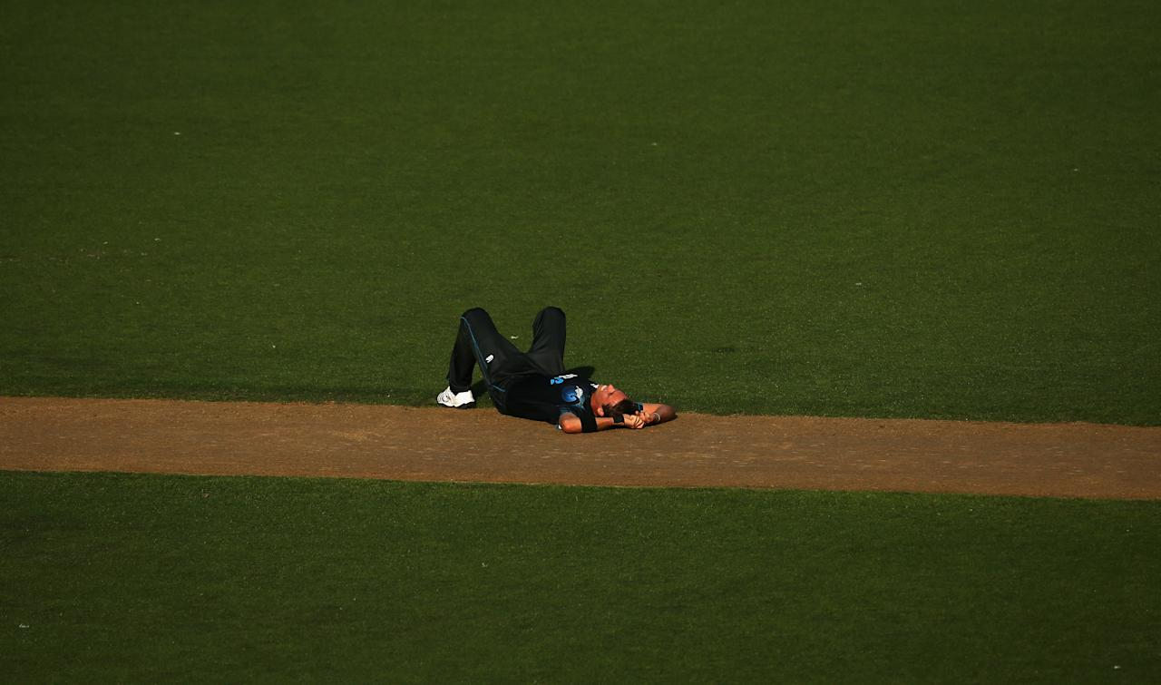 AUCKLAND, NEW ZEALAND - FEBRUARY 23: Tim Southee of New Zealand lies on the pitch during the third game in the International One Day series between New Zealand and England at Eden Park on February 23, 2013 in Auckland, New Zealand.  (Photo by Phil Walter/Getty Images)