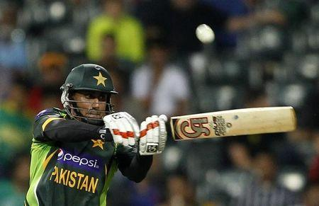 Pakistan's Nasir Jamshed plays a delivery by South Africa's Lonwabo Tsotsobe during their first Twenty20 cricket match in Johannesburg