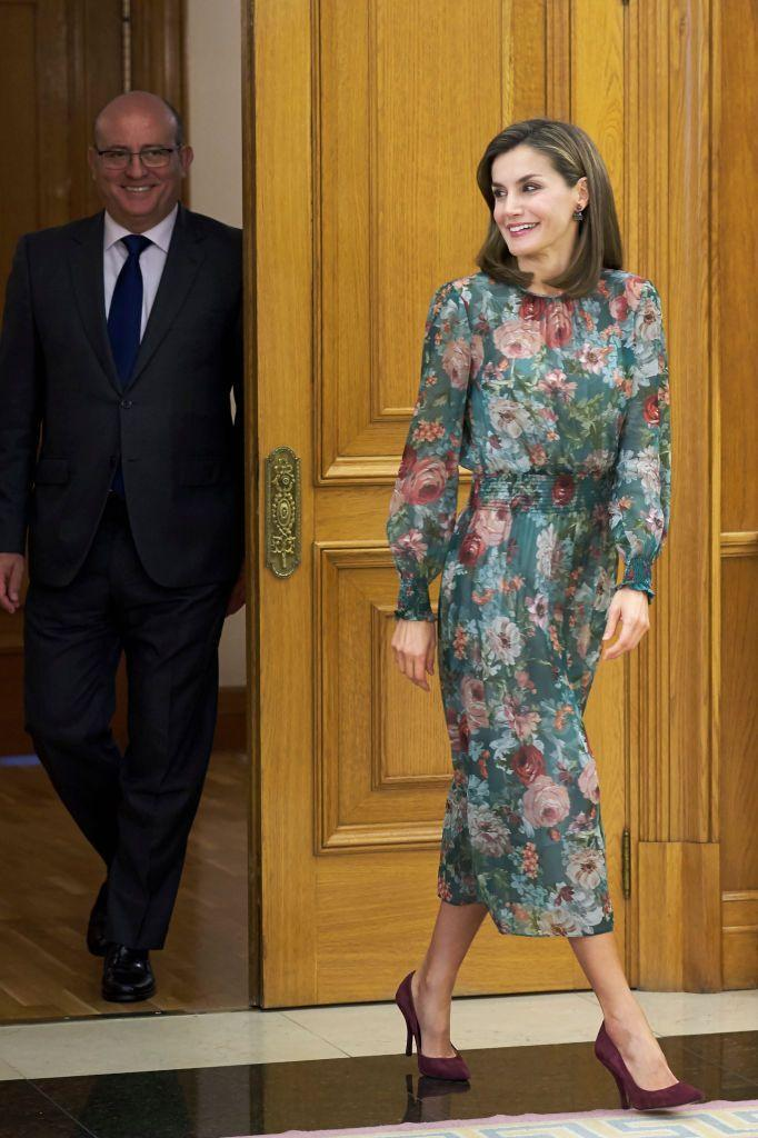 """<p>While attending audiences at Zarzuela Palace, the Spanish royal wore an autumn floral, long-sleeve, midi dress with cinched waist, complete with matching mulberry pumps. The best part about her outfit? The affordable price tag. <a href=""""https://www.zara.com/us/en/printed-midi-dress-p04437289.html"""" rel=""""nofollow noopener"""" target=""""_blank"""" data-ylk=""""slk:Her Zara dress"""" class=""""link rapid-noclick-resp"""">Her Zara dress</a> is selling now for a mere $90, and the fashion line seems to be a trending favorite with other royals like <a href=""""https://www.townandcountrymag.com/style/fashion-trends/news/g1633/kate-middleton-fashion/?slide=19"""" rel=""""nofollow noopener"""" target=""""_blank"""" data-ylk=""""slk:Duchess Kate"""" class=""""link rapid-noclick-resp"""">Duchess Kate</a>.</p>"""