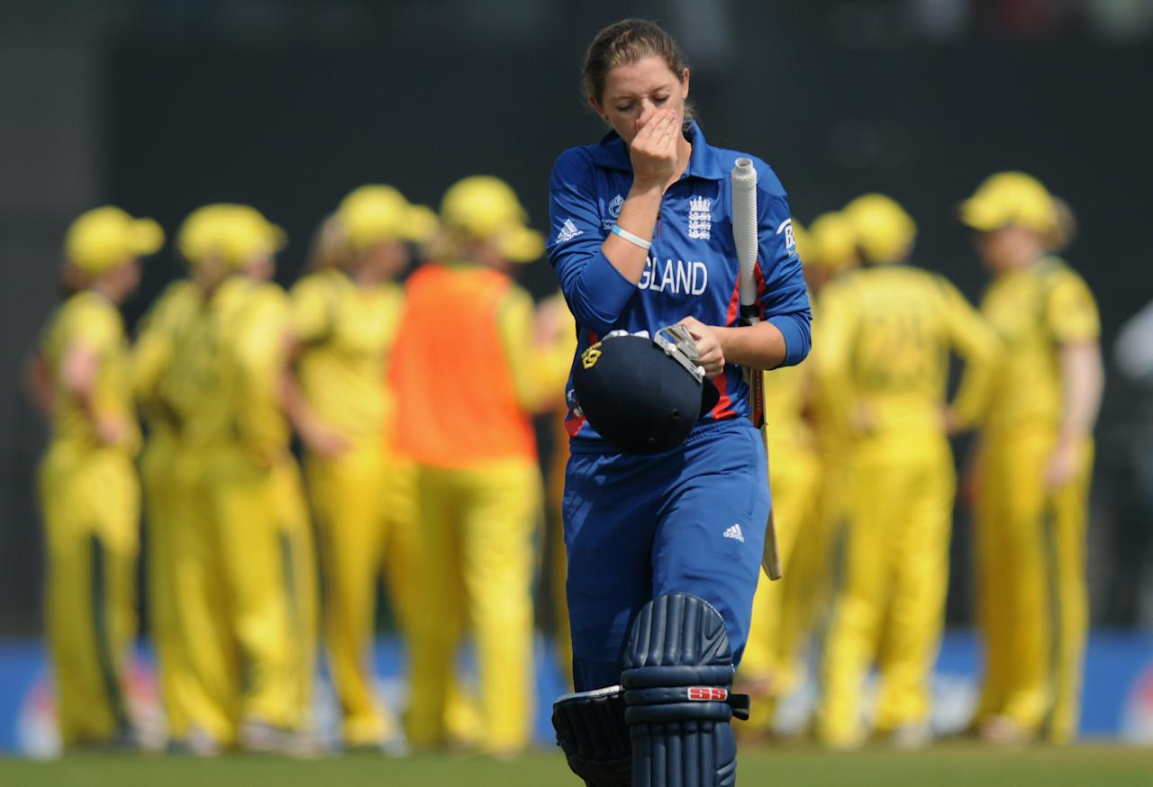 MUMBAI, INDIA - FEBRUARY 08:  Sarah Taylor of England walks back after getting out during the super six match  between England and Australia held at the CCI (Cricket Club of India)  on February 8, 2013 in Mumbai, India.  (Photo by Pal Pillai/Getty Images)