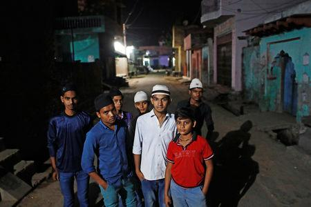 FILE PHOTO: Muslim children stand outside a mosque as they arrive to offer their morning prayer during the holy month of Ramadan in village Nayabans in the northern state of Uttar Pradesh, India May 10, 2019. REUTERS/Adnan Abidi