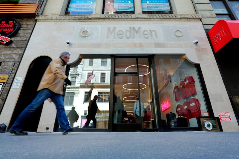 A pedestrian passes the MedMen store on New York's Fifth Avenue on April 20, 2018.