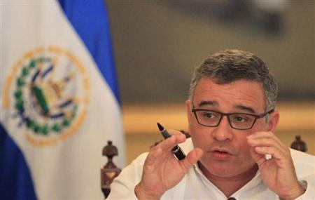 El Salvadoran President Mauricio Funes speaks with journalists in a hall of the presidential palace in San Salvador