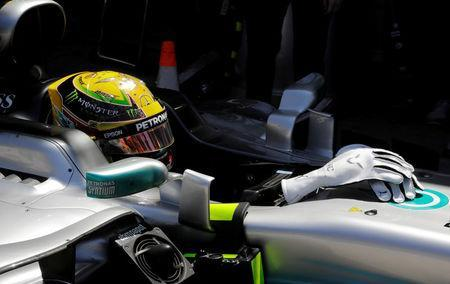 Formula One F1 - Brazilian Grand Prix 2017 - Sao Paulo, Sao Paulo - November 10, 2017. Mercedes' Lewis Hamilton of Britain sits in his car during first practice. REUTERS/Paulo Whitaker