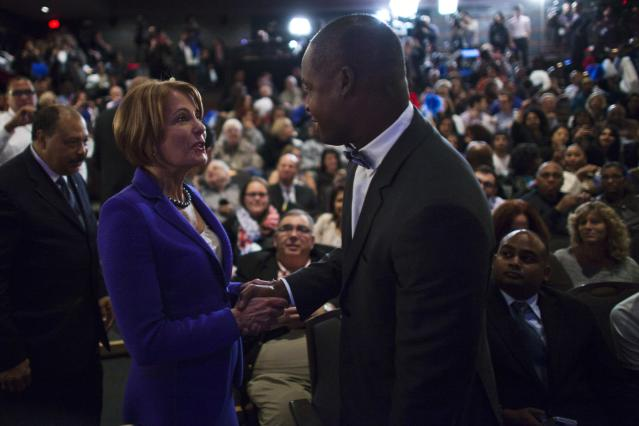 Democratic challenger State Senator Barbara Buono (L) shakes hands with a guest as she attends U.S. Senate candidate Cory Booker campaign's election night event in Newark, New Jersey, October 16, 2013. Democrat Booker, the charismatic mayor of Newark, was the unofficial winner of a New Jersey special election on Wednesday, handily defeating a conservative Republican to fill the state's vacant U.S. Senate seat. REUTERS/Eduardo Munoz (UNITED STATES - Tags: POLITICS ELECTIONS)