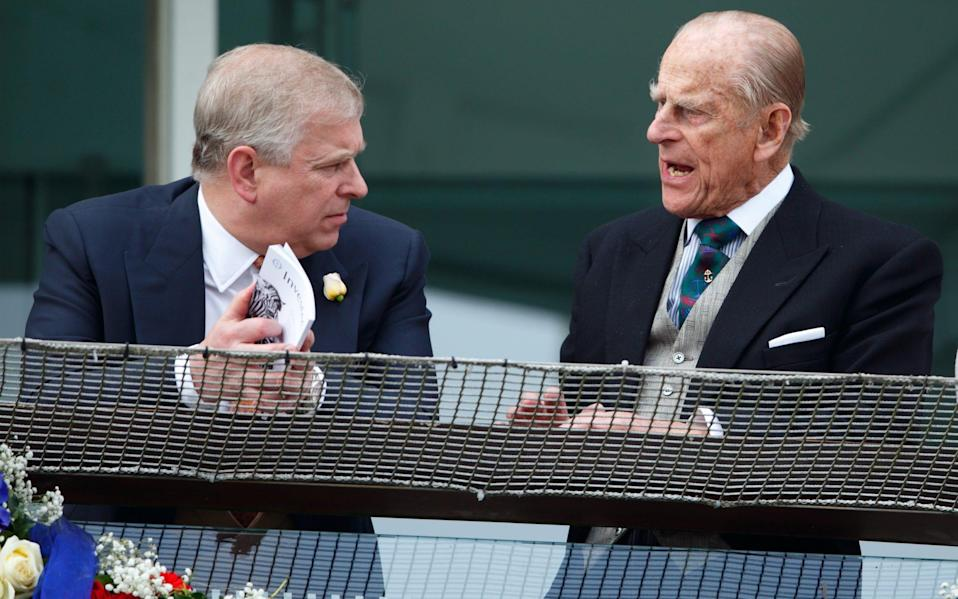 Prince Andrew and Prince Philip, pictured here at the Epsom Derby in 2016, were said to be close - Getty