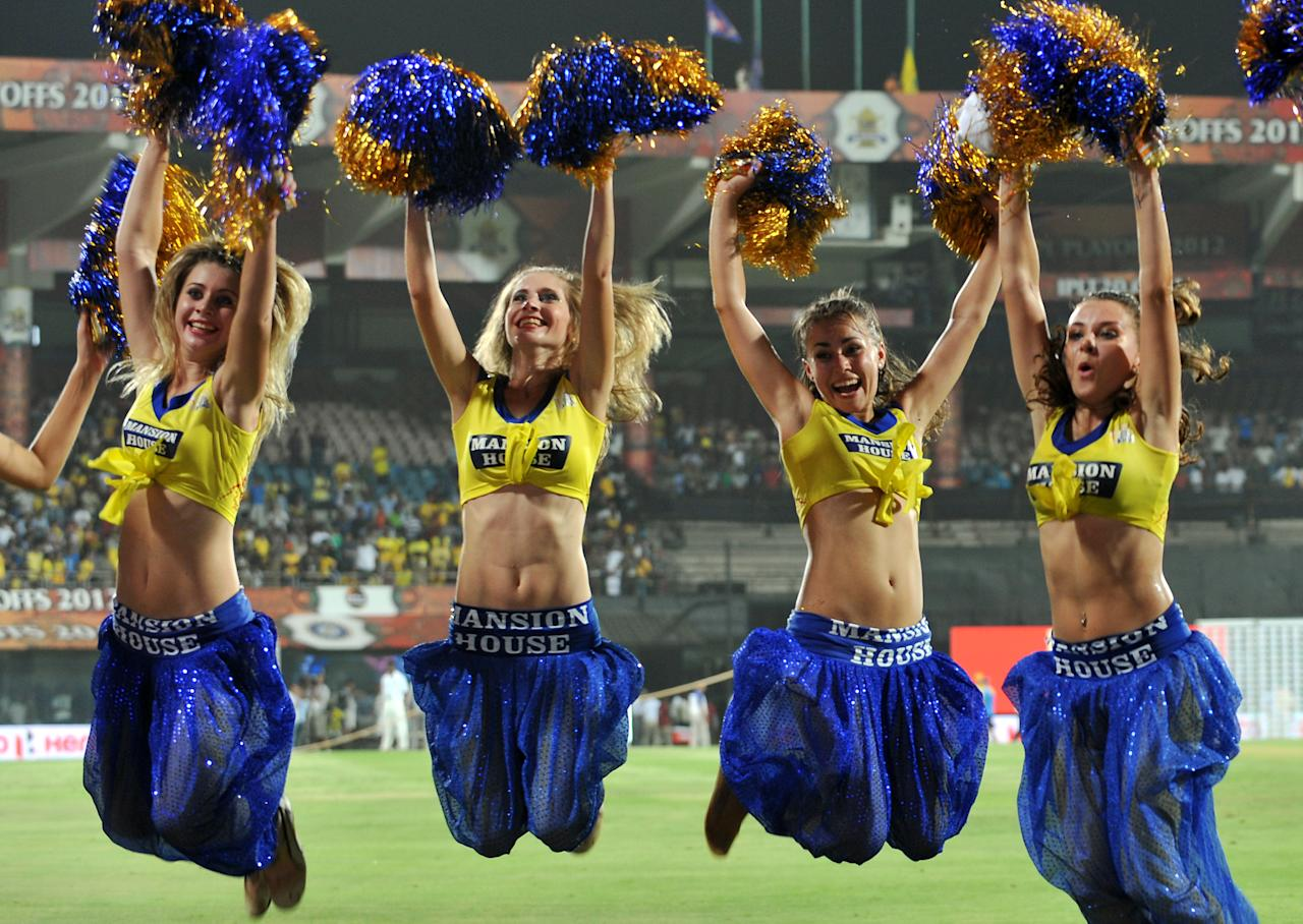 Chennai Super Kings cheer leaders celebrate their team's victory after the IPL Twenty20 cricket 2nd Qualifier match between Chennai Super Kings and Delhi Daredevils at the M.A. Chidambaram Stadium in Chennai on May 25, 2012. Delhi Daredevils lost by 86 run while chasing a target of 223 runs set by Chennai Super Kings. RESTRICTED TO EDITORIAL USE. MOBILE USE WITHIN NEWS PACKAGE. AFP PHOTO/Manjunath KIRAN        (Photo credit should read Manjunath Kiran/AFP/GettyImages)