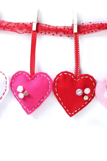 """<p>Make this garland, and you'll be halfway to a more Valentine-ified house! It's way easier than it looks.</p><p><strong>Get the tutorial at <a href=""""https://www.realcoake.com/felt-valentines-day-garland/"""" rel=""""nofollow noopener"""" target=""""_blank"""" data-ylk=""""slk:The Real Thing With the Coake Family."""" class=""""link rapid-noclick-resp"""">The Real Thing With the Coake Family.</a> </strong></p><p><a class=""""link rapid-noclick-resp"""" href=""""https://www.amazon.com/flic-flac-inches-Assorted-Fabric-Patchwork/dp/B01GCRXBVE/?tag=syn-yahoo-20&ascsubtag=%5Bartid%7C10050.g.2971%5Bsrc%7Cyahoo-us"""" rel=""""nofollow noopener"""" target=""""_blank"""" data-ylk=""""slk:SHOP FELT"""">SHOP FELT</a></p>"""