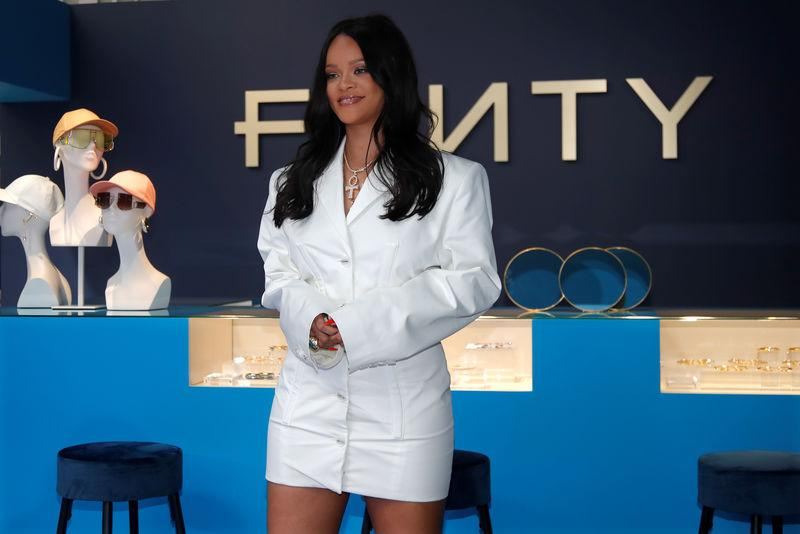 Pop superstar Rihanna poses in a pop-up store to present her first collection with LVMH for the new label, Fenty, in Paris