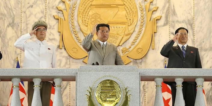 """In this photo provided by the North Korean government, North Korean leader Kim Jong Un, center, waves from a balcony toward the assembled troops and spectators during a celebration of the nation's 73rd anniversary at Kim Il Sung Square in Pyongyang, North Korea, early Thursday, Sept. 9, 2021. Independent journalists were not given access to cover the event depicted in this image distributed by the North Korean government. The content of this image is as provided and cannot be independently verified. Korean language watermark on image as provided by source reads: """"KCNA"""" which is the abbreviation for Korean Central News Agency."""