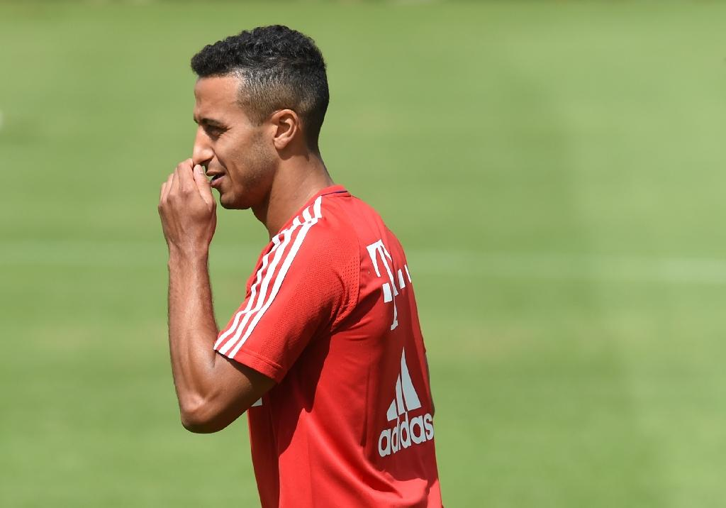 Bayern Munich's Thiago Alcantara has struggled with calf and stomach muscle injuries this season (AFP Photo/Christof Stache)
