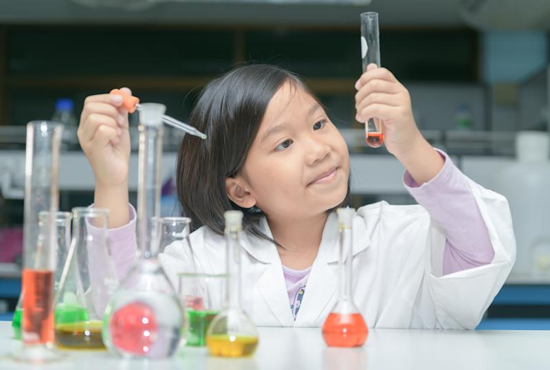 Little girl doing a science experiment