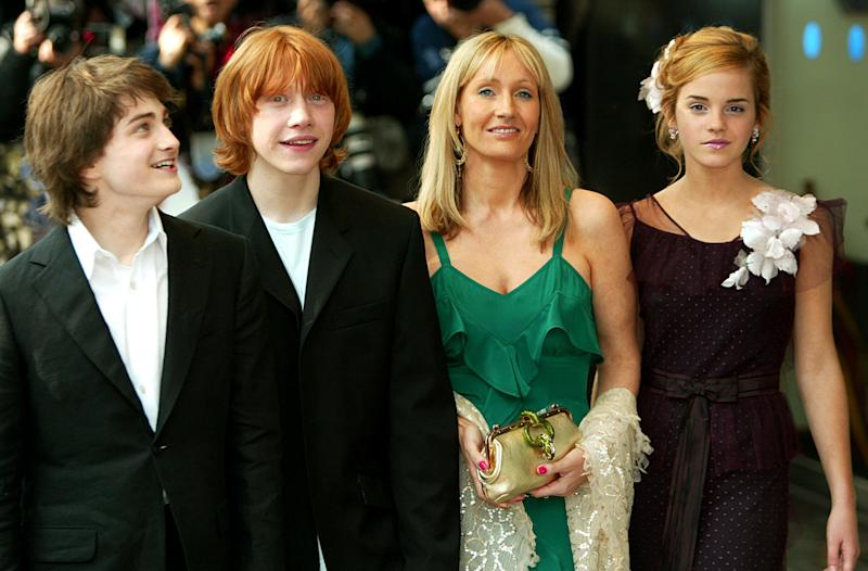 """FILE - This Sunday May 30, 2004 file photo shows Daniel Radcliffe, left, who plays Harry Potter, Rupert Grint, second left, who plays Ron Weasley, and Emma Watson, right, who plays Hermione Granger, at the UK premiere of """"Harry Potter and the Prisoner of Azkaban"""", with author J K Rowling, in London. At last, Harry Potter's adventures are available electronically. The seven novels about J.K. Rowling's boy wizard are for sale as e-books and audio books on the author's Pottermore website, the site's creators announced Tuesday March 27, 2012. The books are available only through the website, which says they are compatible with major electronic e-readers, including Amazon's Kindle and Sony's Reader, as well as with tablets and mobile phones. (AP Photo/John D McHugh, file)"""