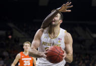 Notre Dame's John Mooney, front, looks for a shot as Syracuse's Bourama Sidibe(34) defends during the first half of an NCAA college basketball game Wednesday, Jan. 22, 2020, in South Bend, Ind. (AP Photo/Robert Franklin)