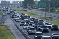 """FILE - In this Saturday, Aug. 28, 2021 file photo, heavy traffic clogs Interstate 10 out of New Orleans as residents and visitors evacuate for the expected arrival of Hurricane Ida in Slidell, La. On Friday, Oct. 1, 2021, The Associated Press reported on stories circulating online incorrectly asserting President Joe Biden has called for a """"driving tax"""" that is estimated to be 8 cents per mile. But what has been proposed is a pilot program that would study the mechanics of such a tax, said Andy Winkler, director of infrastructure projects at the Bipartisan Policy Center. (AP Photo/Steve Helber, File)"""