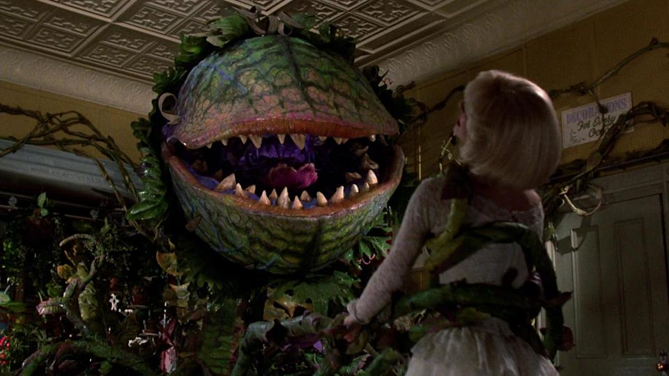 The monstrous Audrey II wants to make a meal of Audrey in <em>Little Shop of Horrors</em>. (Photo: Warner Bros.)