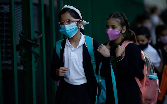 Children line up to enter a school amid the Covid-19 pandemic in Buenos Aires, Argentina on Monday April 19 - Victor R.Caivano / AP