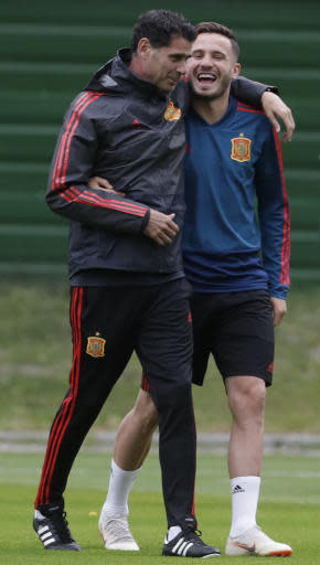 Spain head coach Fernando Hierro, left, smiles with Spain's Saul, right, during the official training on the eve of the group B match between Morocco and Spain at the Mirny stadium in Kaliningrad, Russia, Sunday, June 24, 2018. (AP Photo/Petr David Josek)