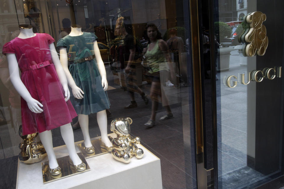 <p> In this July 19, 2012 photo, girls dresses appear on display at the Gucci children's boutique on Fifth Avenue in New York. Gucci's two-level children's boutique on New York's Fifth Avenue, next door to its adult flagship, may have brass teddy bears on the walls and plush child-sized furniture, but the prices for the miniature looks are hardly child's play. (AP Photo/Mary Altaffer) </p>