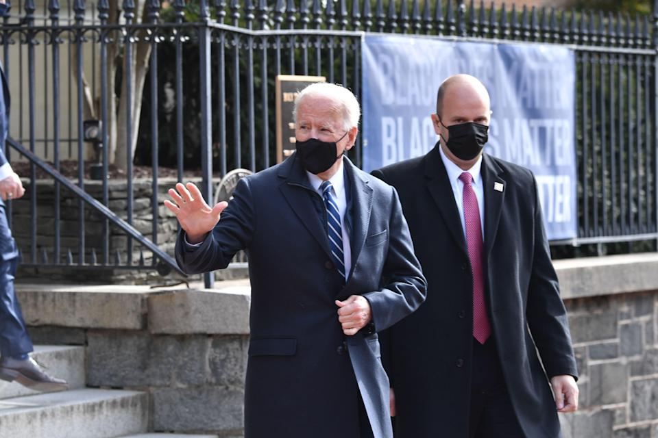 Mr Biden first attended mass - then stopped at a bakery  (AFP via Getty Images)