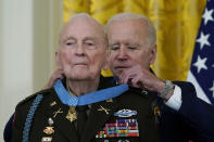 President Joe Biden presents the Medal of Honor to retired U.S. Army Col. Ralph Puckett, in the East Room of the White House, Friday, May 21, 2021, in Washington. (AP Photo/Alex Brandon)