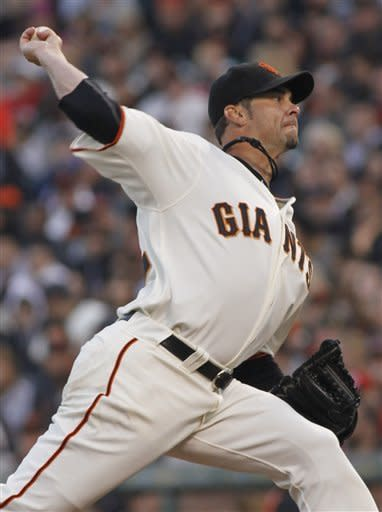 San Francisco Giants pitcher Ryan Vogelsong throws to the Washington Nationals during the second inning of a baseball game, Monday, Aug. 13, 2012 in San Francisco, Calif. (AP Photo/George Nikitin)