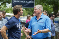 UNITED STATES - AUGUST 14: Rep. Aaron Schock, R-Ill., left, talks with Jim Oberwies, Republican senate candidate for Illinois, during Republican Day at the Illinois State Fair in Springfield, Ill., August 14, 2014. (Photo By Tom Williams/CQ Roll Call)