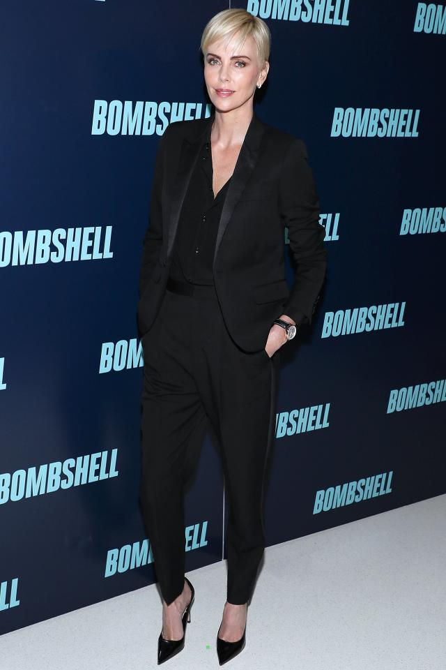 wears all black, featuring a blazer, front-button blouse, fitted trousers and pumps at the <em>Bombshell</em> special screening in Washington, D.C.