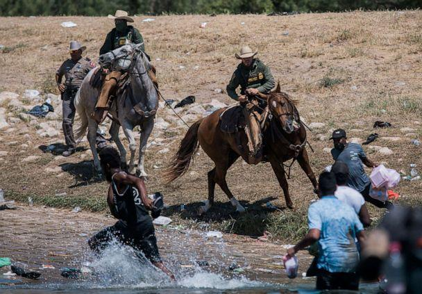 PHOTO: U.S. Customs and Border Protection mounted officers attempt to contain migrants as they cross the Rio Grande from Mexico into Del Rio, Texas, Sept. 19, 2021. (Felix Marquez/AP)