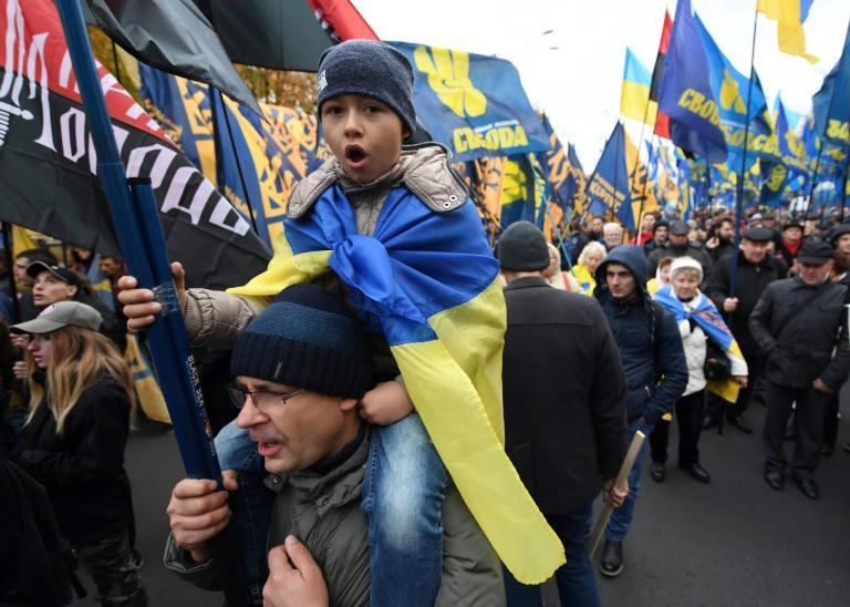 Supporters of Ukrainian far-right parties and movements march in Kiev on the 75th anniversary of the Ukrainian Insurgent Army (UPA)