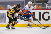 New York Islanders' Oliver Wahlstrom (26) brings the puck upice as Pittsburgh Penguins' John Marino (6) defends during the second period of an NHL hockey game, Saturday, Feb. 20, 2021, in Pittsburgh. (AP Photo/Keith Srakocic)